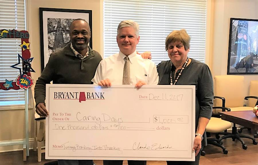 Bryant Bank Presents a check to Caring Days.